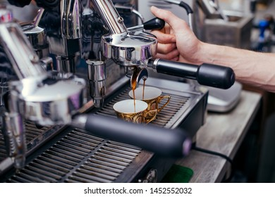 Close up details of brewing machinery pouring and preparing espresso