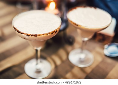 close up details of cocktails. Vodka chocolate long drink margarita served cold in restaurant, pub and bar with cocoa garnish