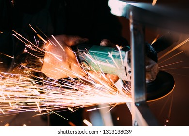 Close up details of electrical rotary angle grinder being used on construction site