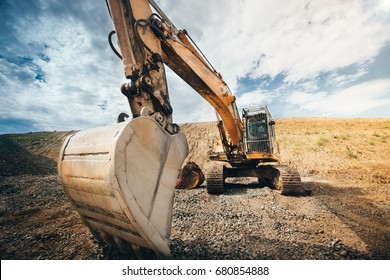 close up details of excavator industrial scoop. engineer working with excavator at construction site