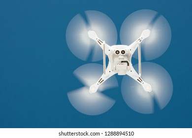 Close up details of flying drone quadcopter. Quadcopter capturing aerial photography and footage with high resolution camera