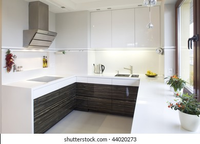 Close up details of luxurious modern fitted kitchen in home.