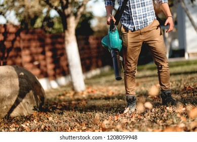 close up details of man using garden blower
