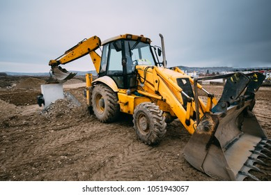 close up details of massive working machinery, industrial backhoe loader with excavator on construction site