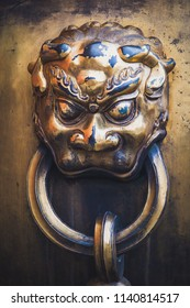 Close up of the details on a bronze basin at the Forbidden City in Beijing, China.