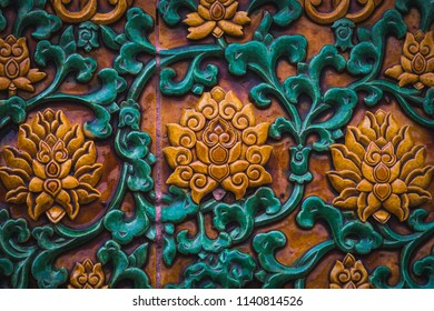 Close up of the details on a doorway at the Forbidden City in Beijing, China.