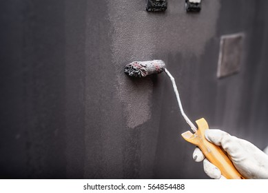 close up details of painting walls, industrial worker using small roller and tools for painting walls