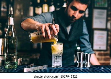 close up details of perfect alcoholic drink, rum with orange juice. Barman preparing lifestyle drink
