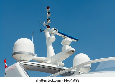 Close details of radar  navigation system and communication tower on a fancy motor yacht