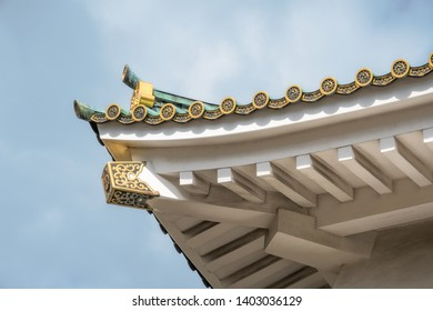 Close up details of the roof structure at Osaka Castle with specific golden roof tile ornaments. Osaka Castle is one of the most famous historic landmarks in Japan.