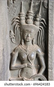 A close up devata bas relief in Khmer temple complex, Angkor Wat, Cambodia, Asia.