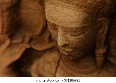 Close up of a devata in ta prohm temple in Angkor