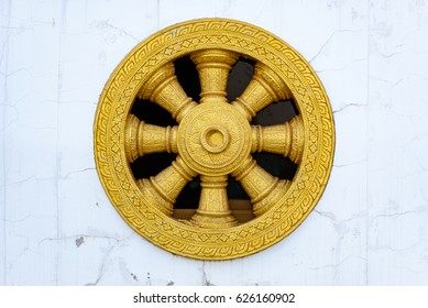 Close up Dharmachakra Wheel of Dhamma in  the temple Thailand.