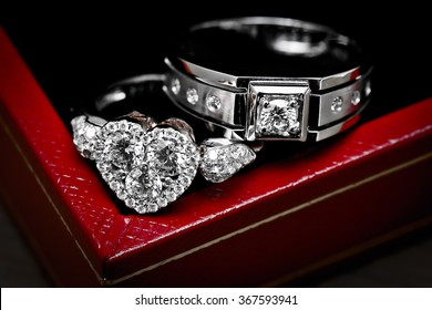 Close up diamond couple wedding rings on luxury red box