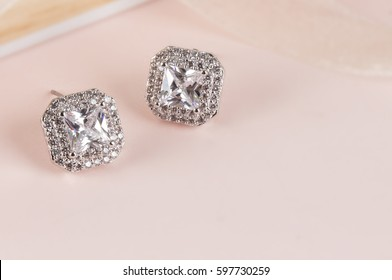 Close up of diamond earrings. space for your text.