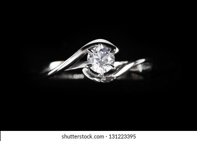 close up of diamond ring with black background