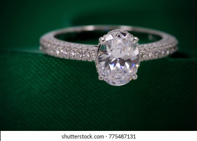 Close up of diamond ring on Green background. ( selective focus). love and wedding concept.