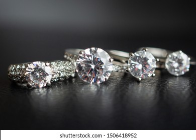 Close up diamond rings jewelry on black leather background