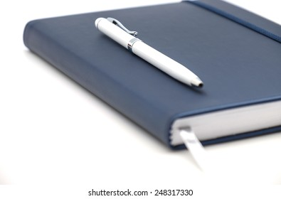 Close up of diary, planner or organizer for business use on white background