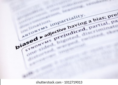 Close up to the dictionary definition of Biased