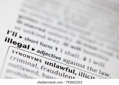 Close up to the dictionary definition of Illegal