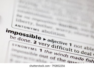 Close up to the dictionary definition of Impossible