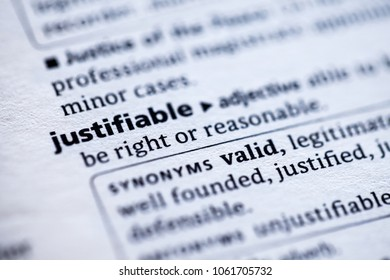 Close up to the dictionary definition of Justifiable