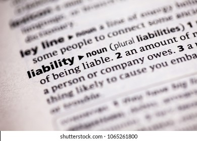 Close up to the dictionary definition of Liability