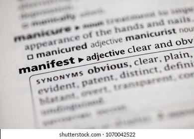 Close up to the dictionary definition of Manifest