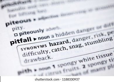 Close up to the dictionary definition of Pitfall