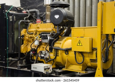 Close up diesel generator unit has a unit mounted radiator and fuel filter system.