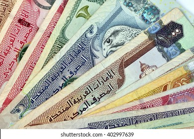Close up different Dirhams currency note and coins, United Arab Emirates  Close up different Dirhams currency note and coins, United Arab Emirates