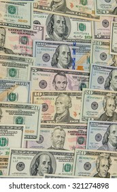 Close up of different dollar bills