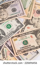 Close up of different dollar bills. Whole background.