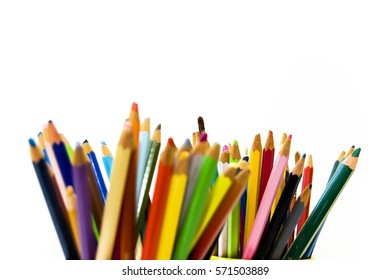 Close up of different, used, blunt, dull and sharpened colored pencils, watercolor pencils on white background, space for text, selected focus