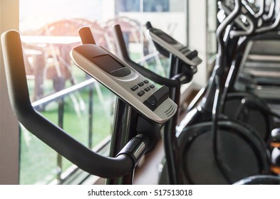 Close up digital display screen control exercise bike equipment interior gym and modern  fitness room center