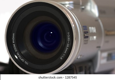 Close up of digital video camera over white background