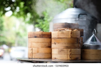 close up dim sum in bamboo steamer,yumcha of chinese cuisine with blurry background