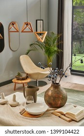 Close up dinner table and living room background style, interior concept, lamp and garden view, plate glass of water book on the desk.