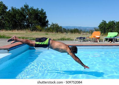 Close up of a dip in the pool as a concept of summer relaxation.