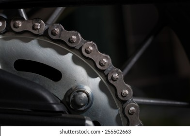 Close up of dirt and rust on motorcycle chain.