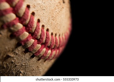 Close up of a dirty baseball shot on a black background