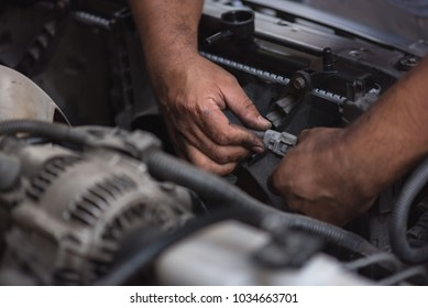 Close up dirty mechanic hand try to fix engine in maintenance service.