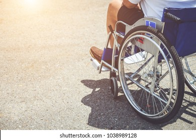 Close up disabled people sitting on the wheelchair in the park