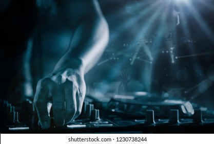 Close Up Disc Jockey (DJ) Entertainment with EDM Dance Music Mixer CD Player in Night Club with Lighting and Smoke Effect in Holiday