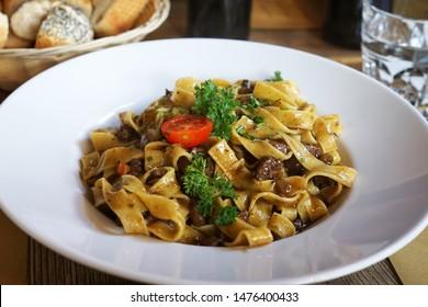 Close up dish of Tagliatelle fettuccine with wild venison deer ragout ragu , Trentino-Alto Adige recipe