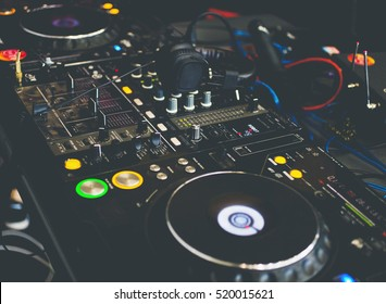 Close up DJ console with DJ headphones.