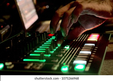 Close up of DJ hands mixing music at electronic party festival