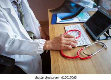 Close up  doctor busy working at his desk