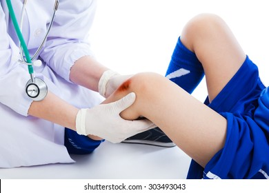 Close up doctor examining a patient suffering from injured with a bruise. Sport injury. Professional checking knee injury athlete, on white background. Studio shot